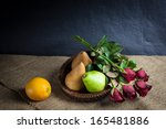 Still life fruits, fresh fruit display in wooden plate and some place on sack cloth - stock photo