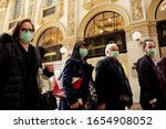 Small photo of MILANO,ITALY- FEBRUARY 22, 2020: Coronavirus in Italy.Protective mask.Tourists in face masks at the Wiktor Emanuel II Gallery