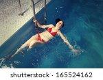 young in red bikini  woman in... | Shutterstock . vector #165524162