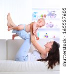 mother playing with baby | Shutterstock . vector #165537605