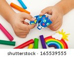 Child Playing With Colorful...