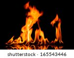 fire flames on black background | Shutterstock . vector #165543446
