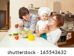 happy young parents with a baby ... | Shutterstock . vector #165543632