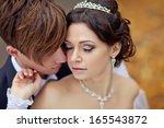 wedding shot of bride and groom ... | Shutterstock . vector #165543872