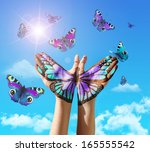 hand and butterfly hand... | Shutterstock . vector #165555542