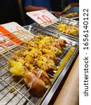 Small photo of Grilled squid on a charcoal stove.grilled squid in Street foods.Squids Roasting On Barbeque Grill