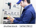 portrait of an electrician at... | Shutterstock . vector #165615812