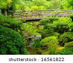 Footbridge Over A Pond At The...