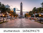Small photo of Tunis, Tunisia - Nov 19, 2019: Habib Bourguiba Avenue with the clock tower at the end