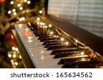 A Piano With Christmas Lights...