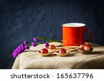 Red grapes in wooden plate on table, still life - stock photo