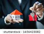 Real Estate Agents Hold The...