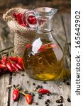 glass bottle of olive oil with... | Shutterstock . vector #165642902