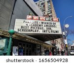 """Small photo of New York City, New York / USA - February 22 2020: Marquee of the IFC Center in Greenwich Village announcing the movie """"Parasite"""" as the winner of four Academy Awards."""