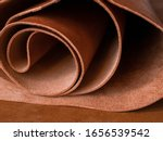 Small photo of Genuine Leather. Sewing a purse. Leather work. Tools for sewing bags, wallets, clutches. Stitching. Manual sewing of the product. The manufacture of leather products.