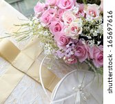 Wedding bouquet of roses, bag and elegant box with bow. - stock photo