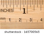 close up of a wood ruler... | Shutterstock . vector #165700565
