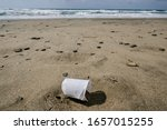 Plastic Glass On Sandy Sea...