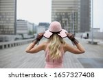 The Blonde Girl In A Pink Hat...