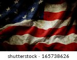 closeup of grunge american flag | Shutterstock . vector #165738626