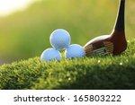 golf balls and wooden driver on ... | Shutterstock . vector #165803222