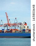 container stack and ship under... | Shutterstock . vector #165803648