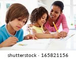 mother helping children with... | Shutterstock . vector #165821156