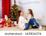 happy mother with her daughter... | Shutterstock . vector #165826376