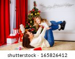 happy mother with her daughter... | Shutterstock . vector #165826412