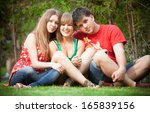 two girls and young man sitting ... | Shutterstock . vector #165839156