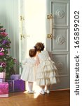 two little sisters opening the... | Shutterstock . vector #165859202