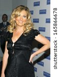 Small photo of Lee Ann Womack, at Avon Foundation 50th Anniversary Celebration, American Museum of Natural History, New York, NY, October 25, 2005
