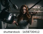 Small photo of creepy demoniacal girl with levitating kitchenware in kitchen