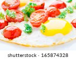 fried eggs with cherry tomatoes   Shutterstock . vector #165874328