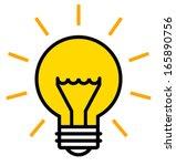 Shining light bulb vector icon - stock vector