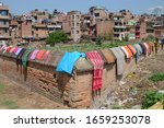 Small photo of Bhaktapur, Nepal - 28th March, 2015: Mundane life of Nepalese people. Clothes dry on the fence.