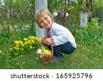Boy With Easter Basket Hunting...