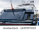 Small photo of MALAGA, SPAIN - Feb 02, 2020: Rear view of Paul Allen's yacht named Octopus moored at harbor