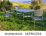 Picnic Table And Chairs On The...