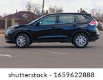 Small photo of Washington DC, USA - February 29, 2020: Photo of black Nissan Rogue in the open air.