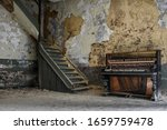 Piano By A Staircase In An Old...