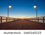 Sunrise On The Pier. Pier...