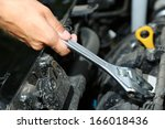 hand with wrench. auto mechanic ... | Shutterstock . vector #166018436