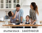 Overjoyed young family with...