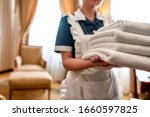 Cropped Shot Of Hotel Maid In...
