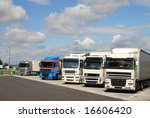 Trucks parking on a row, while the drivers taking a break. - stock photo