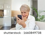 Confused Senior Woman Having...