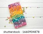 rainbow chocolate bar on a... | Shutterstock . vector #1660904878