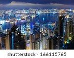 hong kong city by night  | Shutterstock . vector #166115765