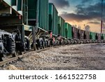 The freight train passes by the ...